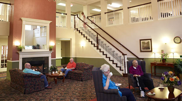 Relax in the lobby at senior living in Flint, MI