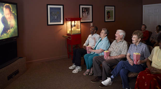 Senior living in Flint, MI has a movie theater for residents to enjoy