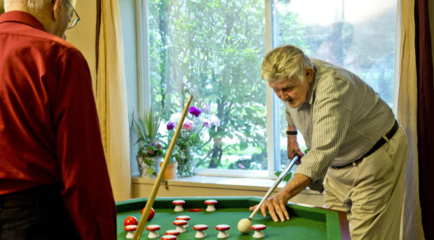 Take a break in the game room at senior living Royal Oak, MI