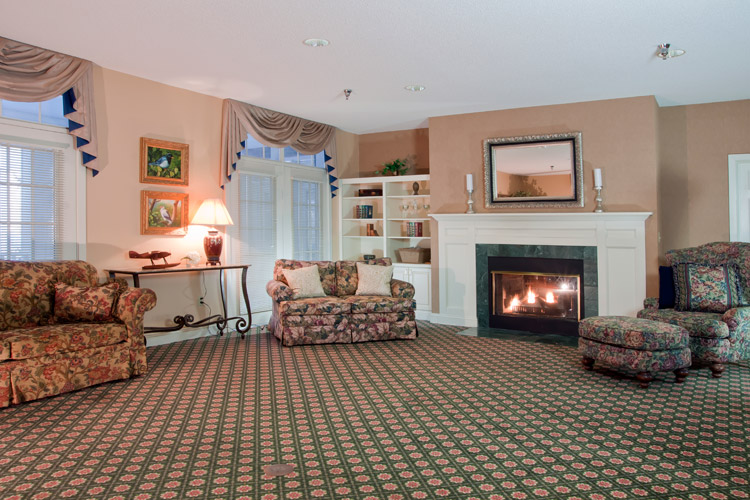 Warm fire place at senior living community in Woodbury, MN