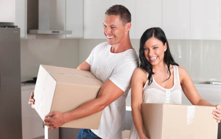 Couple moving boxes to a self storage facility in Washington