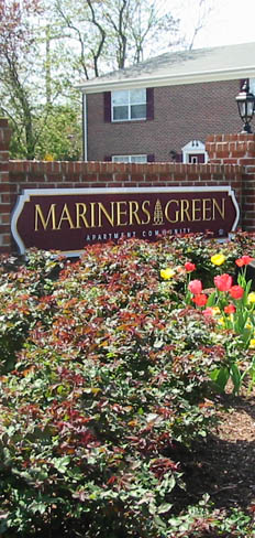 Landscaping and sign at apartments in Newport News