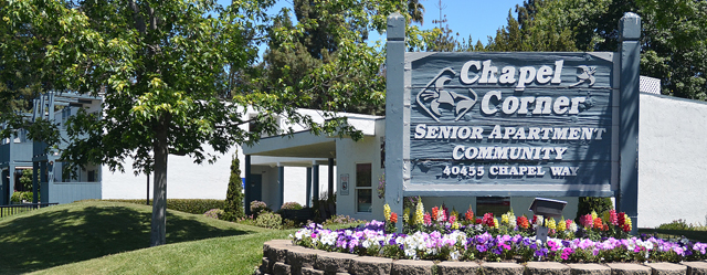Welcoming sign at Chapel Corner senior living community