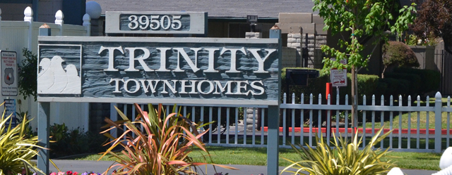 Welcoming sign at Trinity Townhomes in Fremont, CA