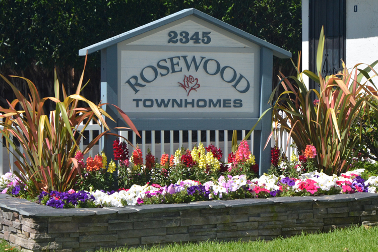 Welcoming sign at Rosewood Townhomes
