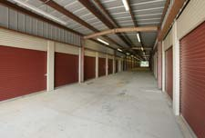 Covered aisle ways keep you protected at Douglasville storage units.