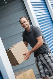 Man packing to move into storage units for rent in Grayslake.