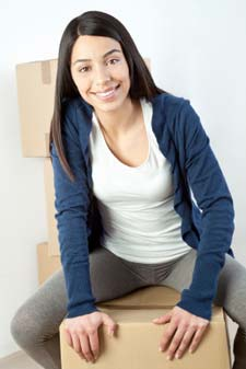 A young woman takes a break from moving to learn about our Stanhope storage units.