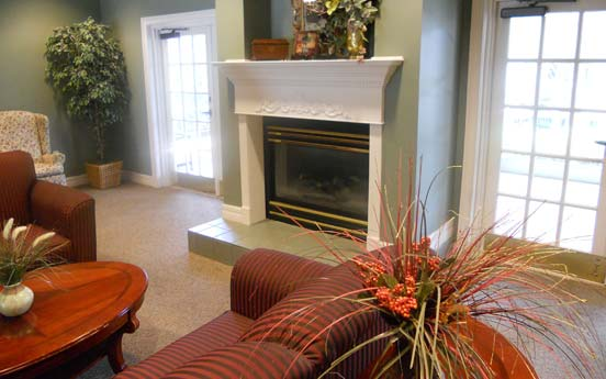 Fireplace sitting area at Savannah Court of Orange City