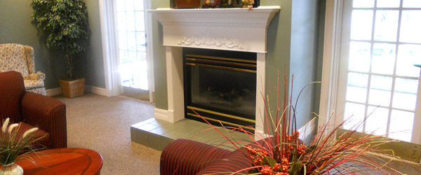 Orange city fl senior living fireplace in the community room