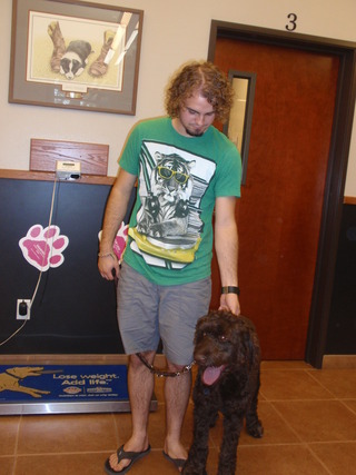 Man and his dog at animal hospital in Boise, ID