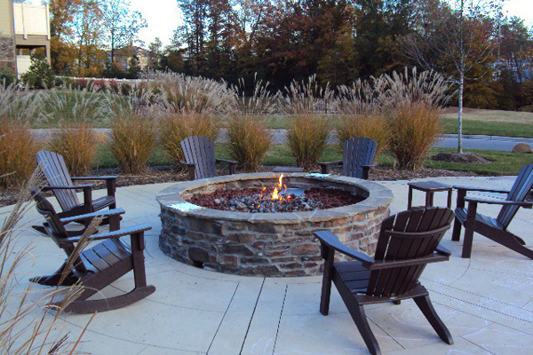 Relax around the fire pit at Cosgrove Hill apartments in Chapel Hill