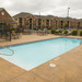 Take a dip in the swimming pool at apartments in Manhattan, KS