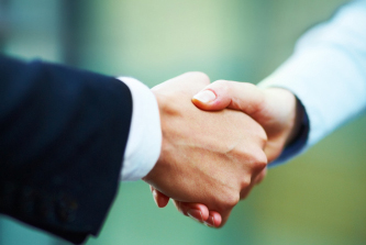 People shaking hands property management services