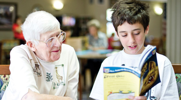 Reading to senior in charlevoix
