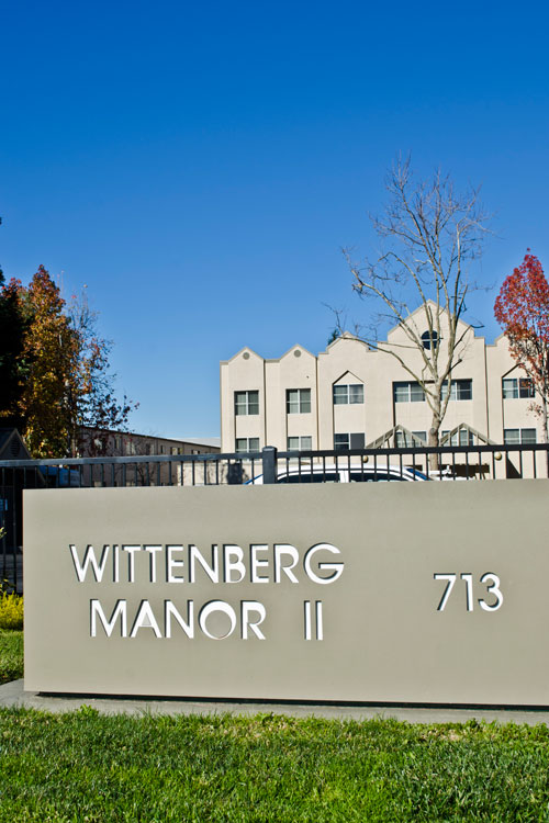 Welcoming sign at entry of Wittenberg Manor in Hayward, CA