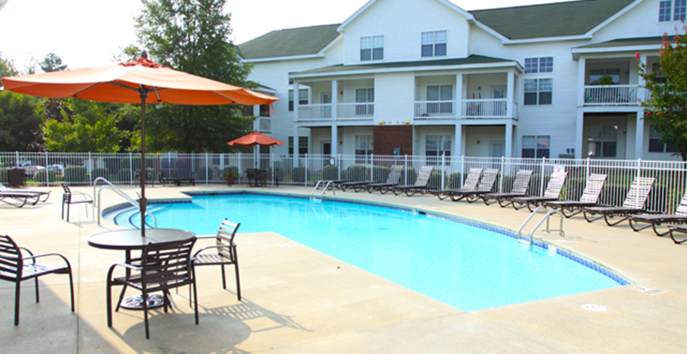 Sundeck and pool at Raleigh apartments