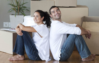 Couple resting while moving their belongings into self storage