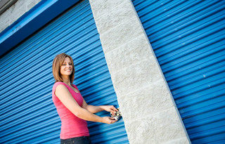 Woman locking a storage door