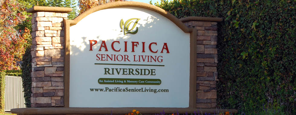 Stone sign at riverside memory care entrance