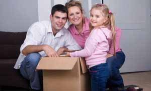 family with boxes for storage at ABC in Spokane