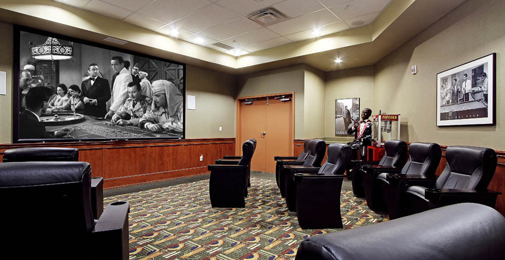 Relax with your favorite film in the movie theater at senior living in Kent