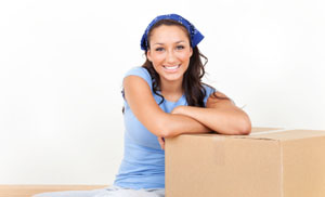 Woman packing boxes for self storage in Spokane