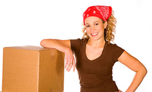 woman with boxes and packing supplies