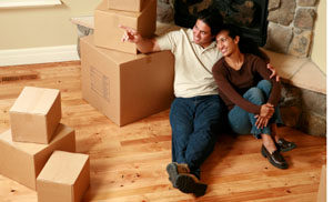 Couple with cardboard boxes at home in Spokane, WA