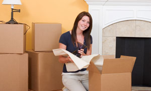 Woman packing household items for storage