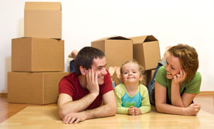 family with boxes for storage in Spokane