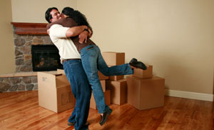 couple hugging and cardboard boxes for storage