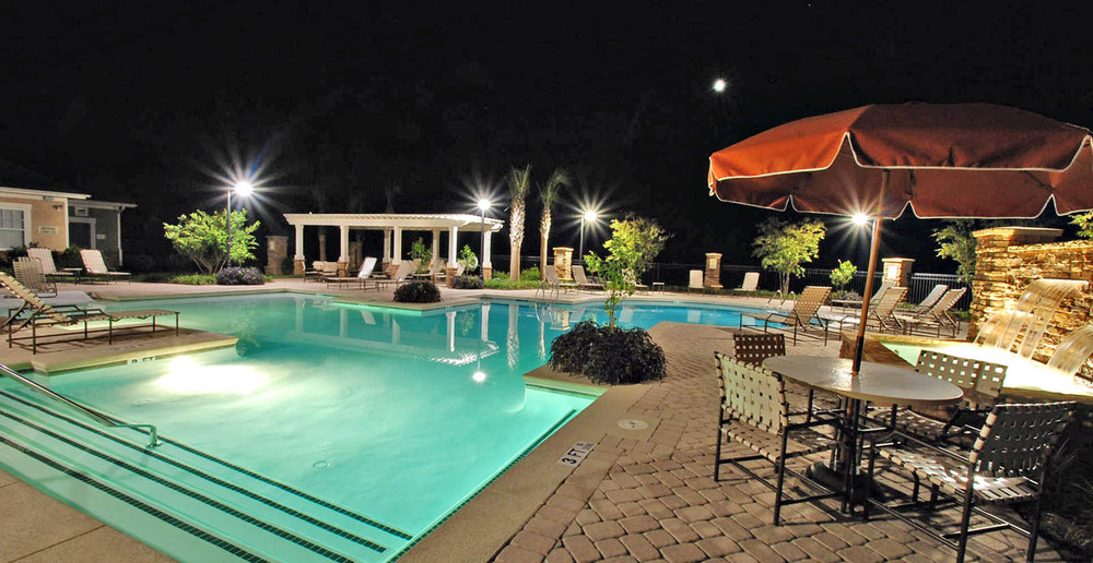 Pooler apartments swimming pool at night