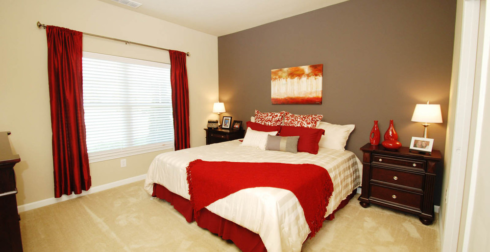 Relax in a spacious bedroom at Pooler apartments