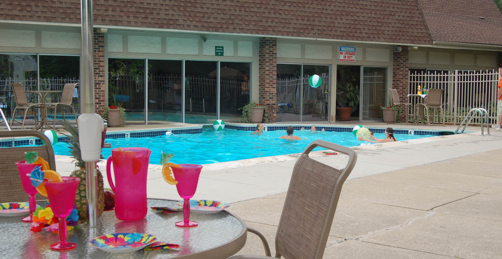 East Lansing apartments have an outdoor swimming pool