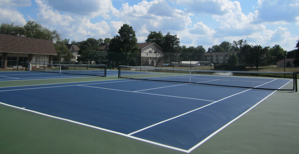 Outdoor tennis court at East Lansing apartments