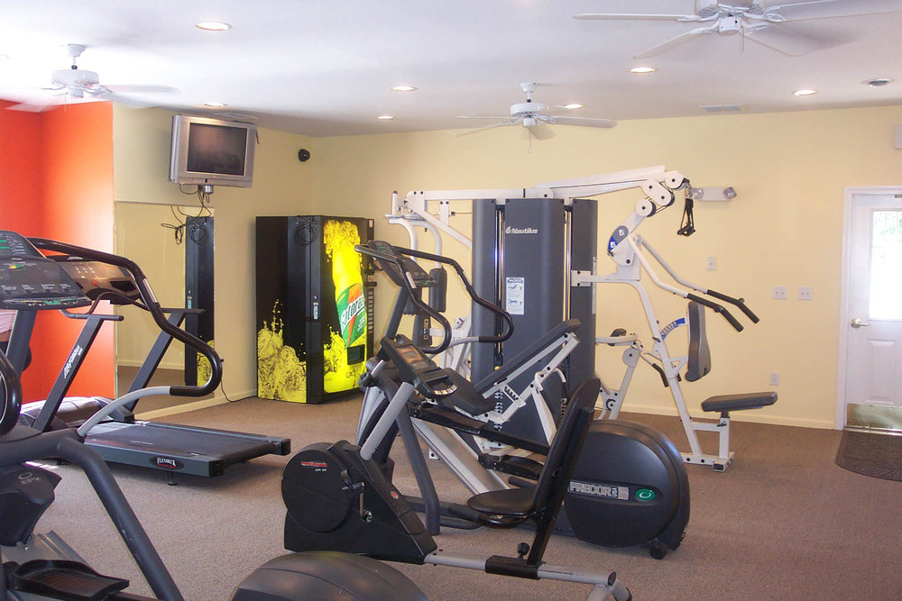 Work out in the fitness center at apartments in Lansing