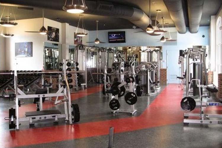 Weight room at apartments in Fayetteville