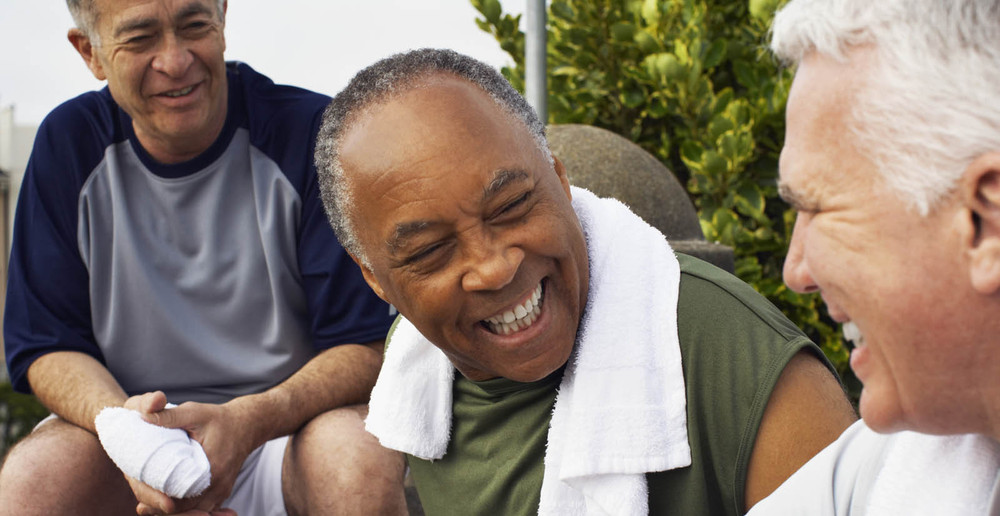 Senior men with gym towels at independent living in Seattle