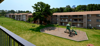 Large recreation area and playground at Fairfax apartments