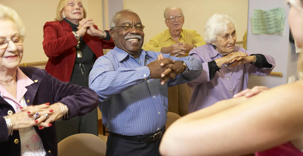 Seniors stretching at independent living in Kent, WA