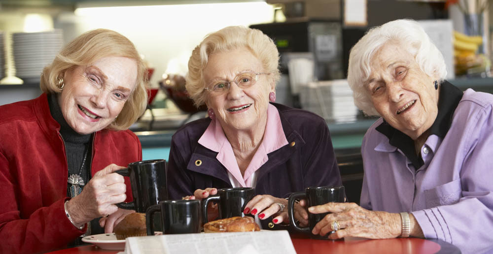 Three women drinking tea Kent senior independent living