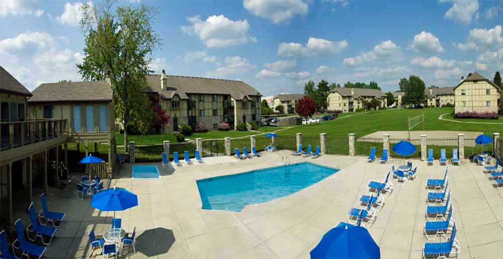 Pool with sun deck at apartments in dayton