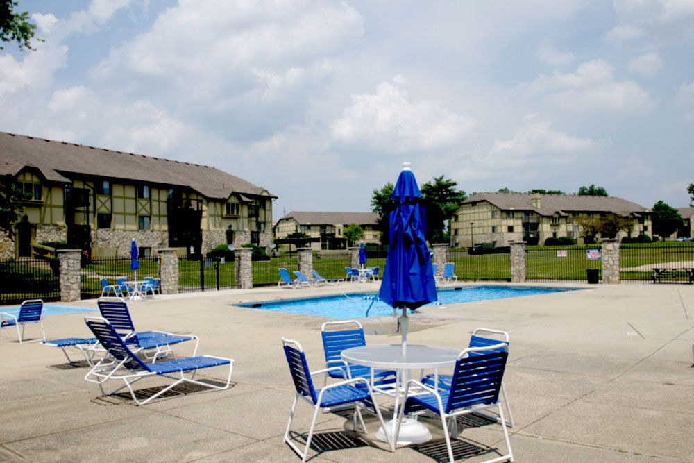 Relax by pool at apartments in dayton