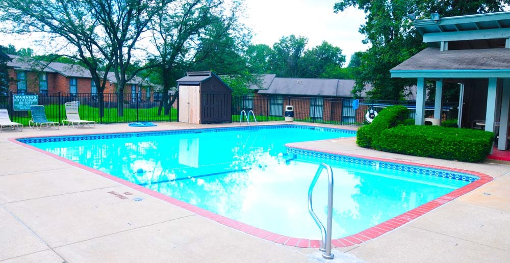 Relax in the pool at Ferguson MO Townhomes