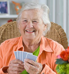 friends enjoy a game of cards at senior living in