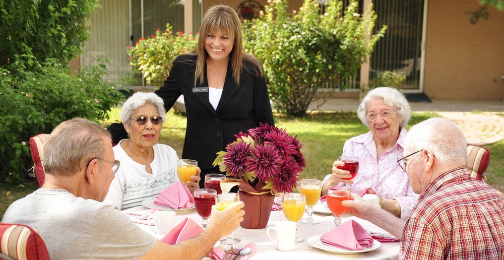 Happy residents dining at senior living in Tucson