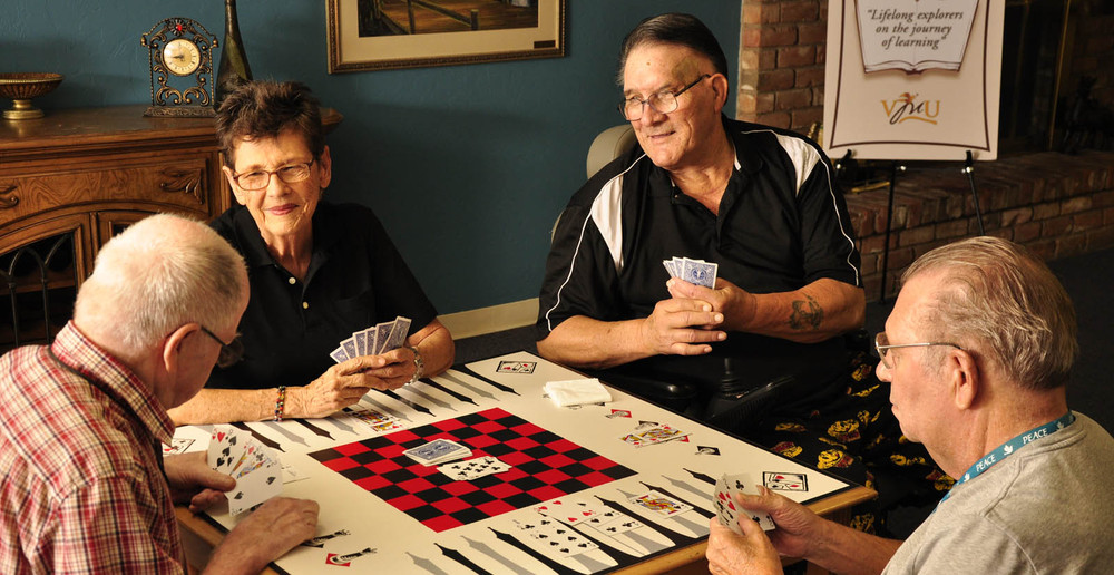 Tucson senior living residents playing cards