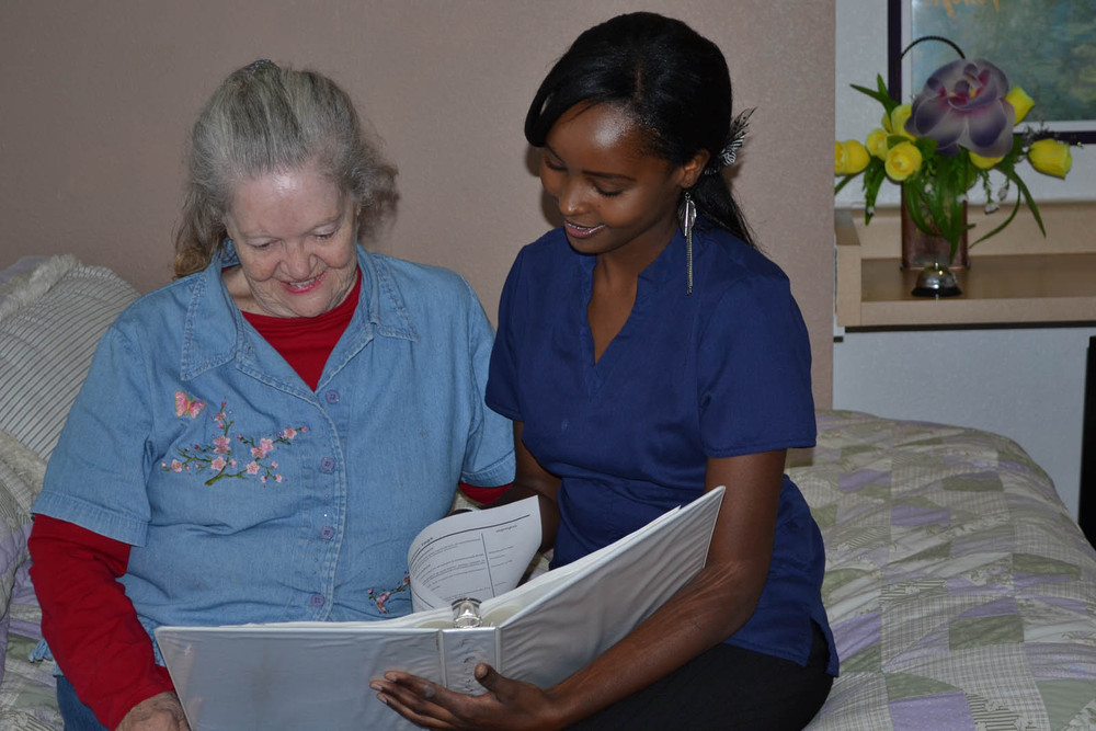 Reading to a resident at senior living in Mesa