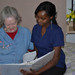 Thumb-reading-to-a-resident-senior-living-in-mesa